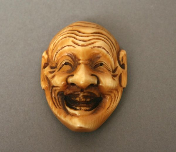 9: Ivory Netsuke of a Smiling Face or Mask
