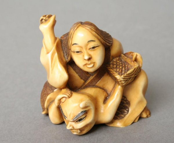14: Netsuke of Devil and Lady