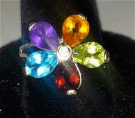 custom 14K flower ring peridot ruby amethyst diamond