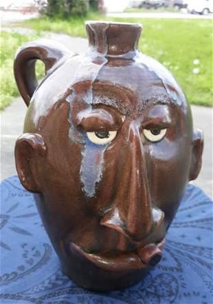 "Dal Burtchaell Pottery Face Jug 11"" w/cigar great glaze"