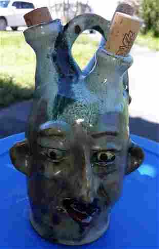 """Tim Whitten Trio Spout Pottery face jug green 9"""""""