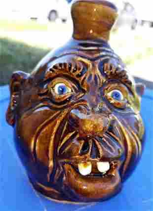 "Dwayne Crocker Pottery face jug blue eyes 5 1/2"""
