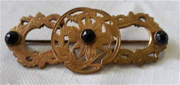 Victorian brooch with jet black stones gold?