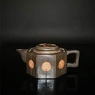 Chinese zisha teapot and cover..(Mark of Wang nanlin)
