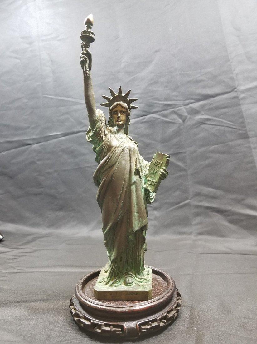 A bronze status of liberty figure