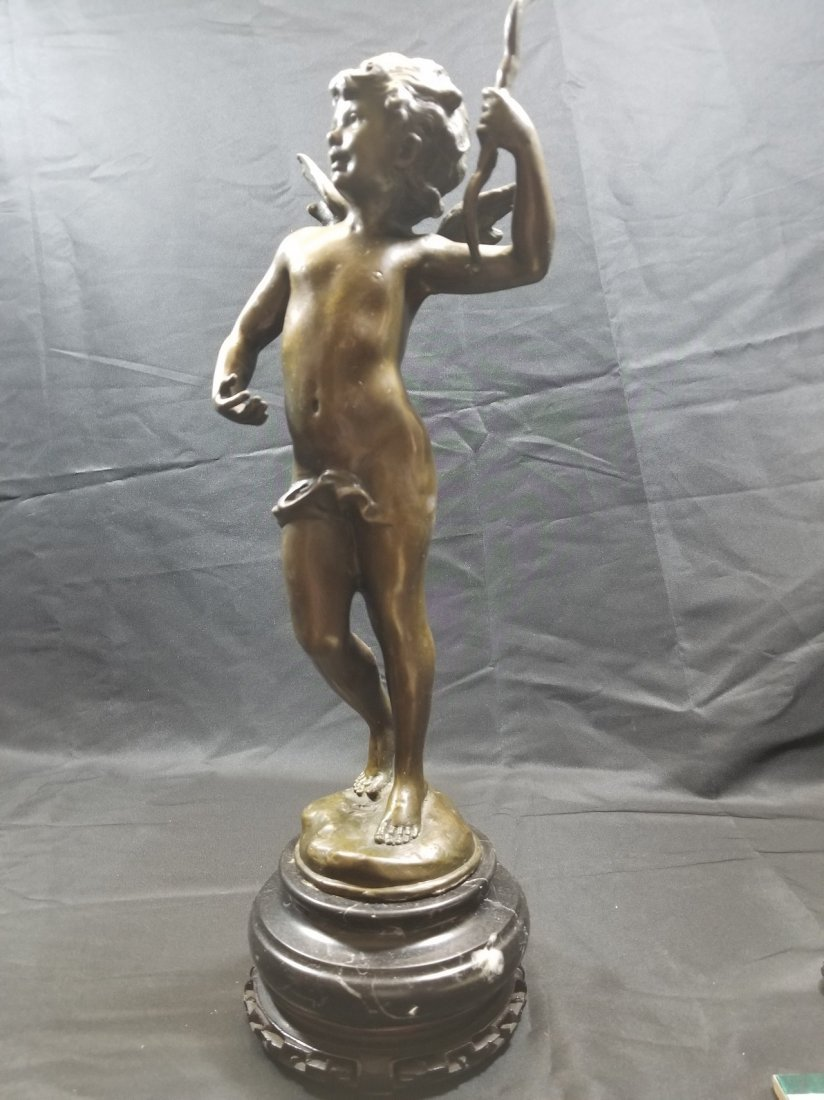 vintage bronze cupid figure