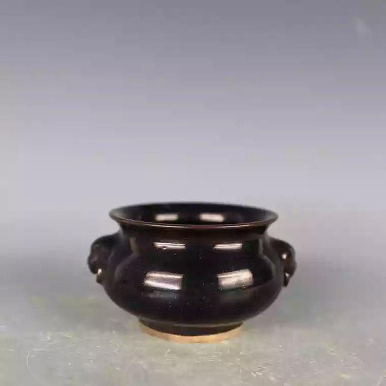 A black glazed Chinese porcelain jar