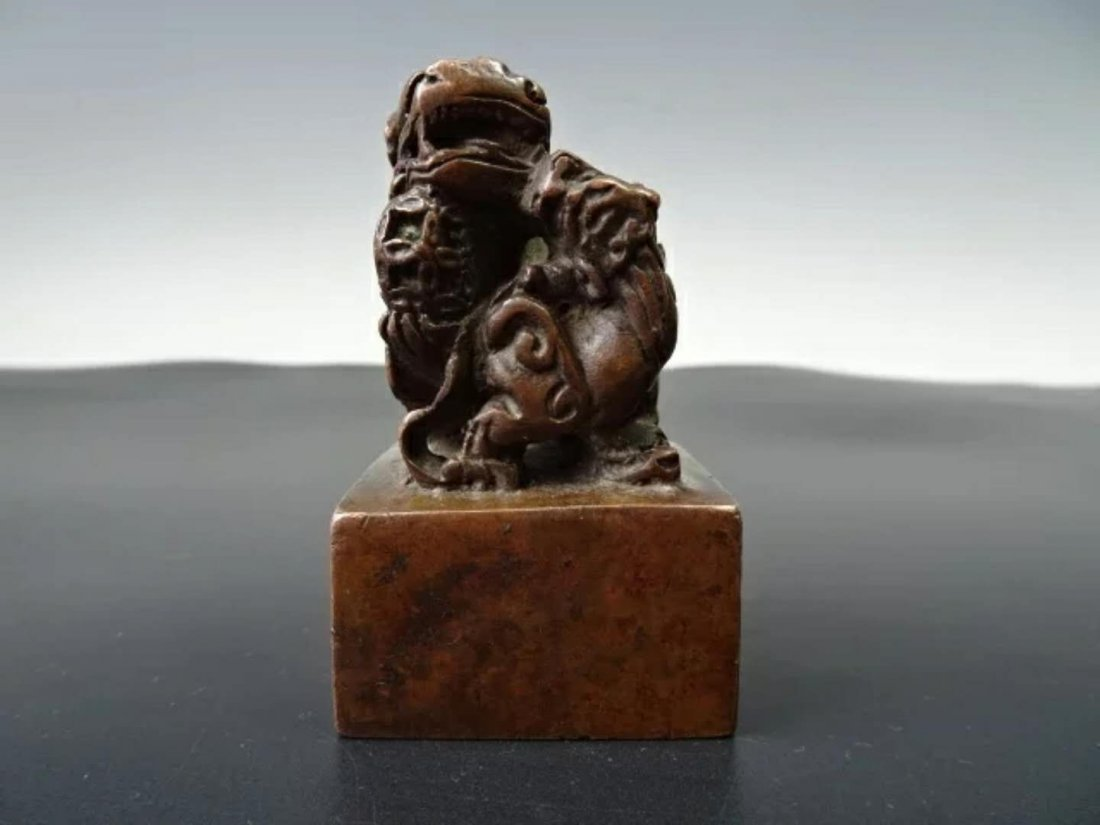 A carved bronze seal