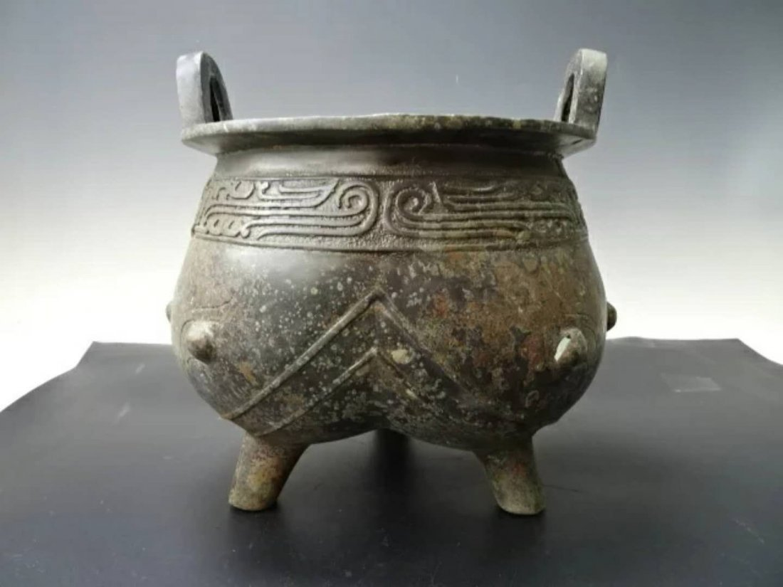 A carved  bronze  burner censer