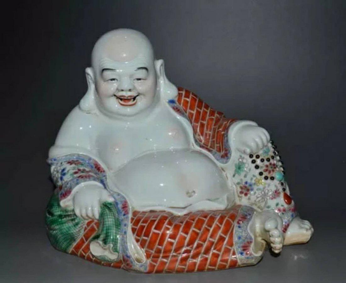 A famille rose porcelain Buddhist figure