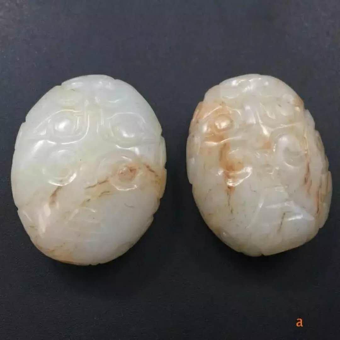 Pair of carved white jade bead