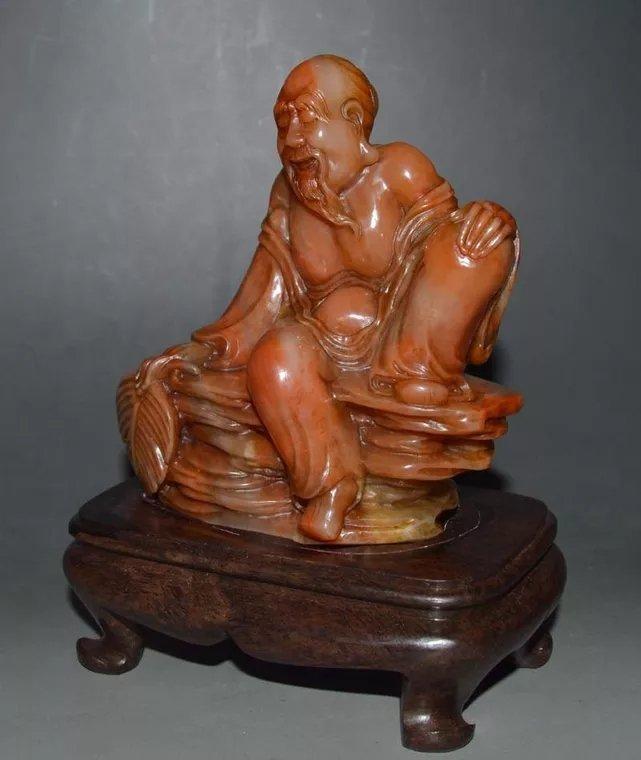A Chinese Buddhist figure sopstone