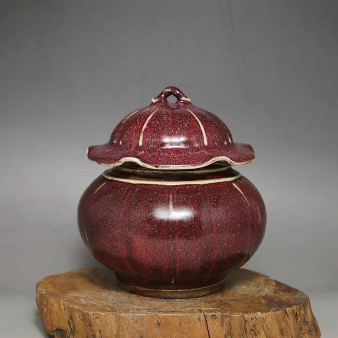 A red glazed porcelain cover jar