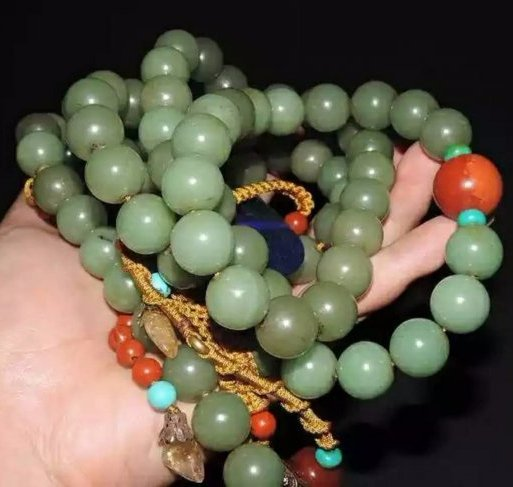 A long jade bead necklace