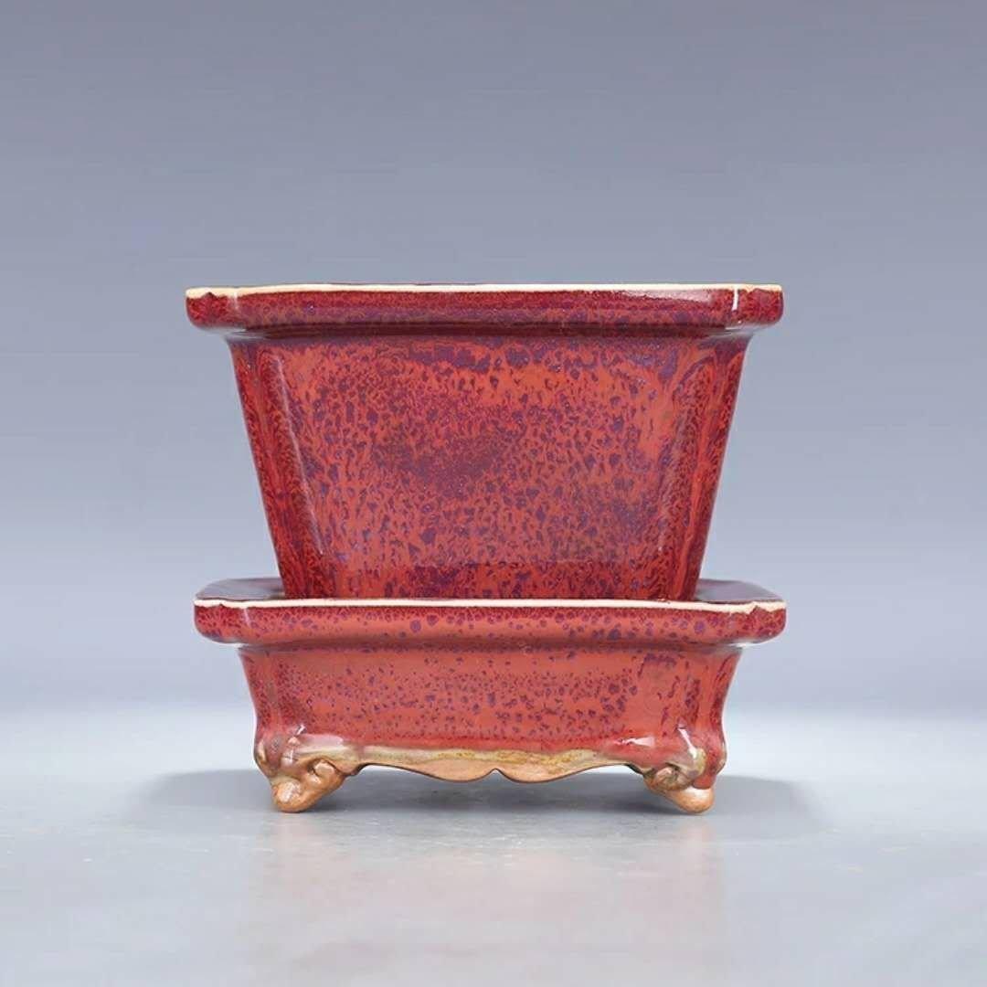 A red glazed porcelain planter