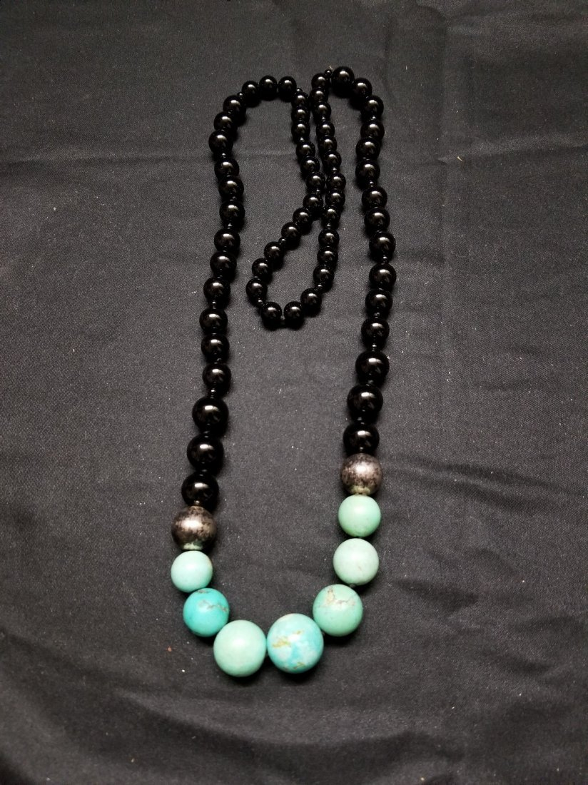 A crystal and turquoise bead