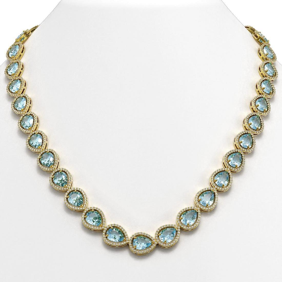 41.6 CTW Sky Topaz & Diamond Halo Necklace 10K Yellow