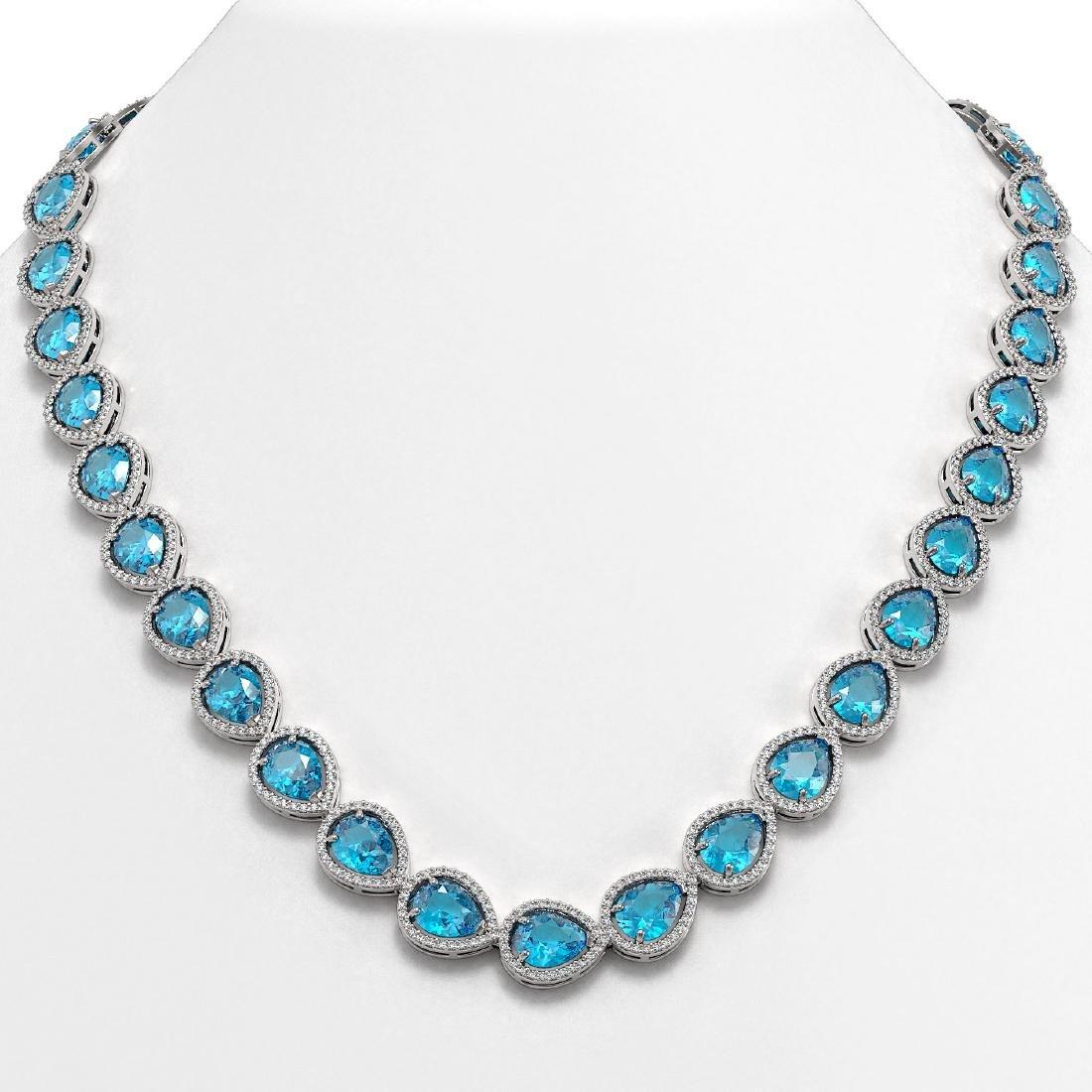 43.2 CTW Swiss Topaz & Diamond Halo Necklace 10K White