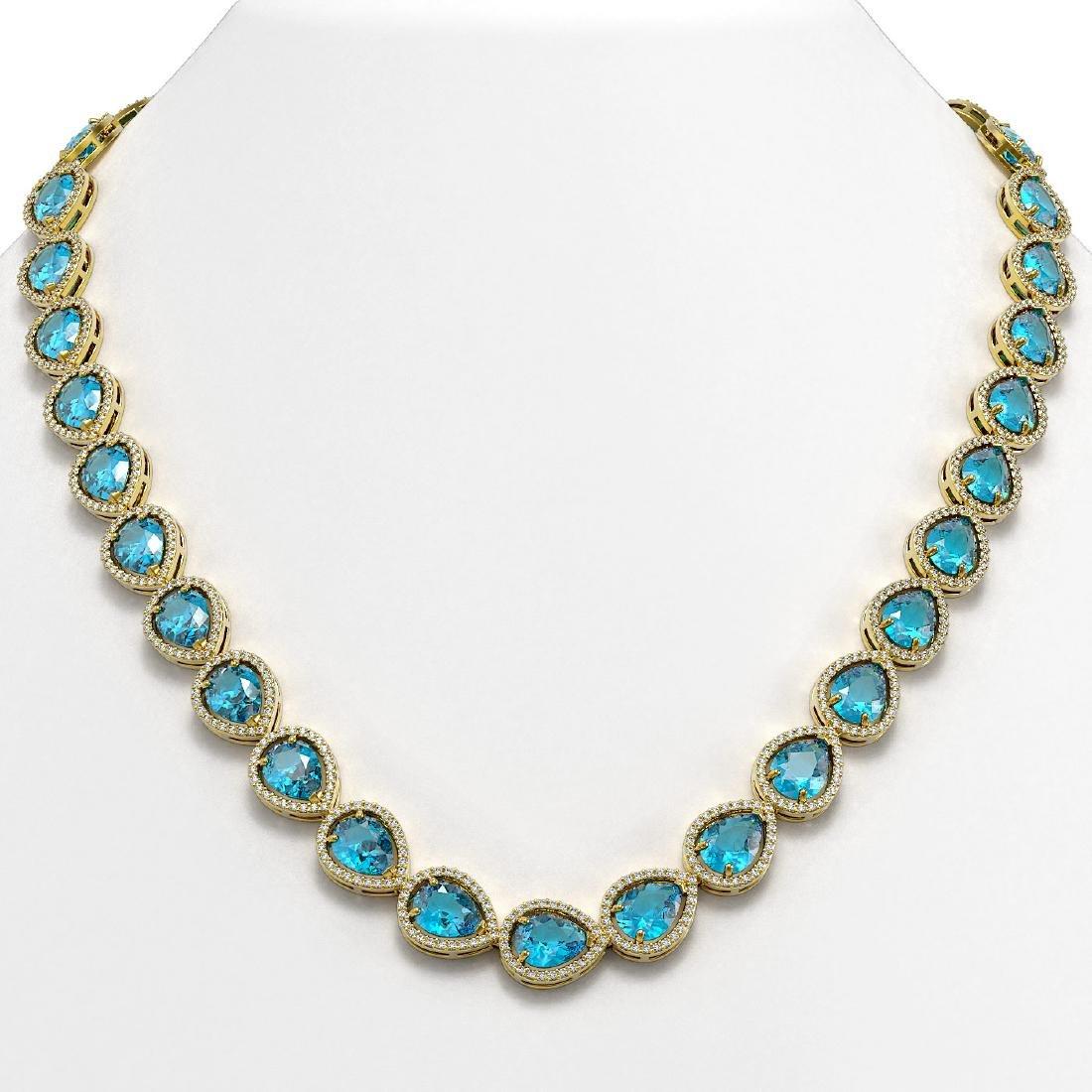 43.2 CTW Swiss Topaz & Diamond Halo Necklace 10K Yellow