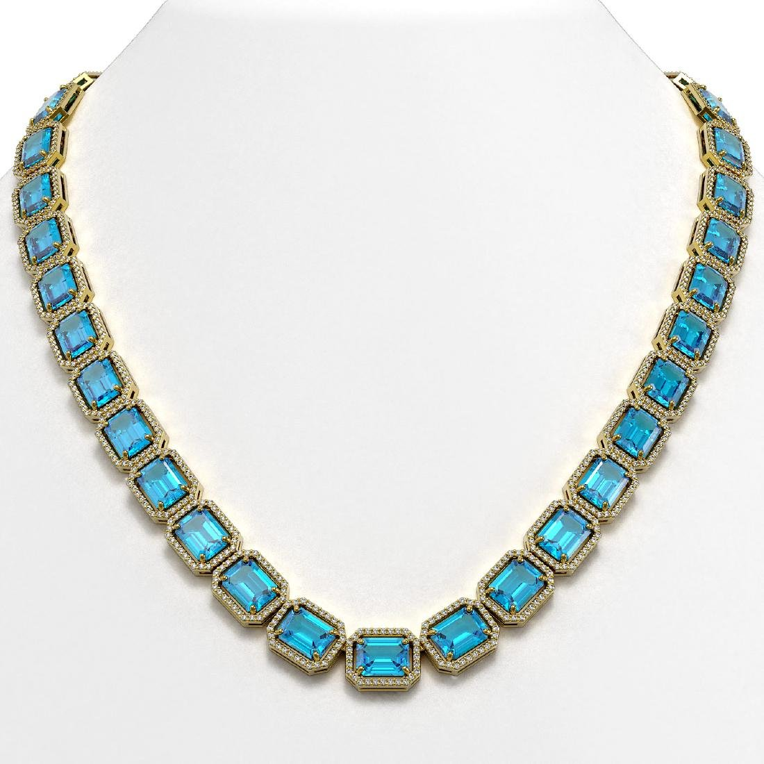 79.01 CTW Swiss Topaz & Diamond Halo Necklace 10K