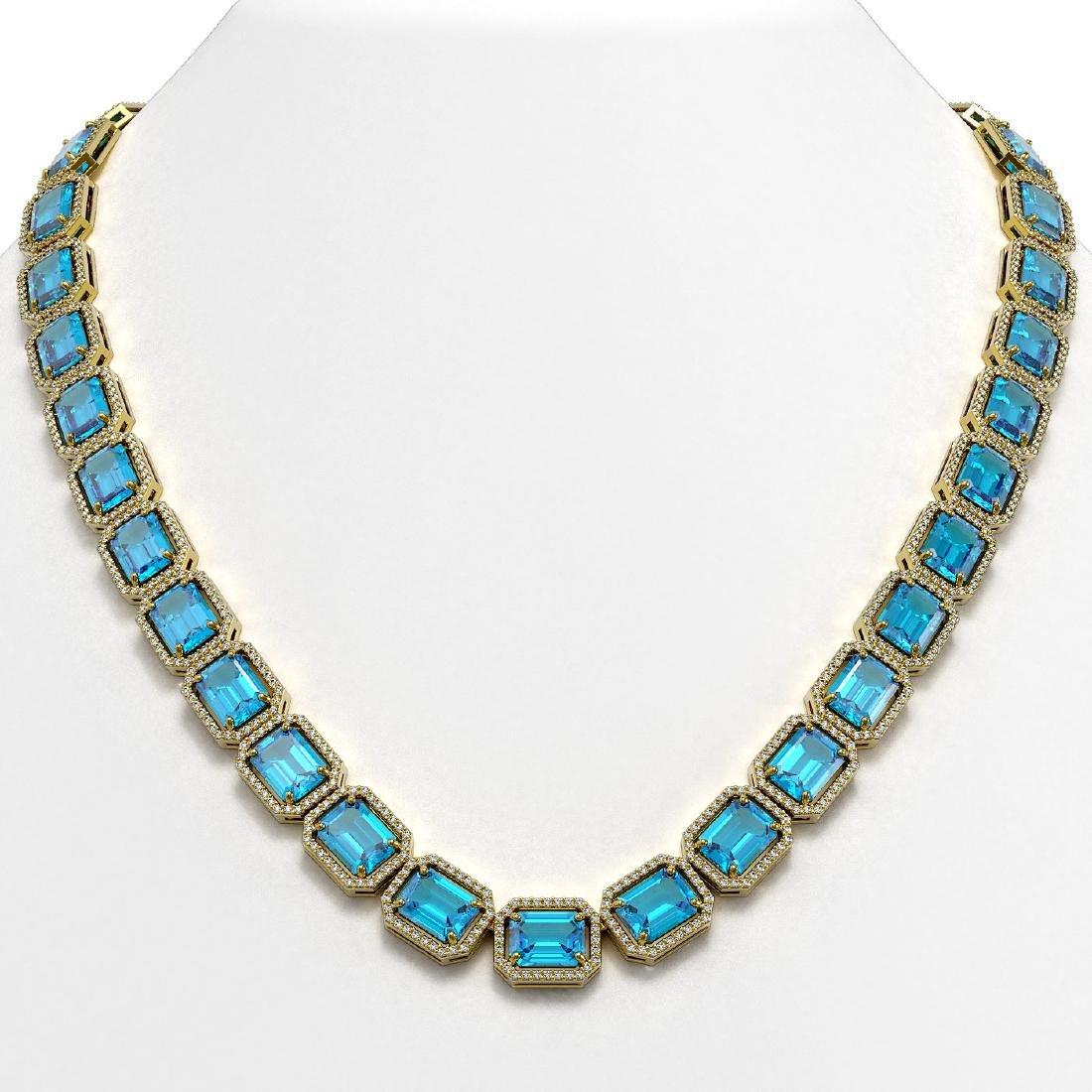 79.01 CTW Swiss Topaz & Diamond Halo Necklace 10K