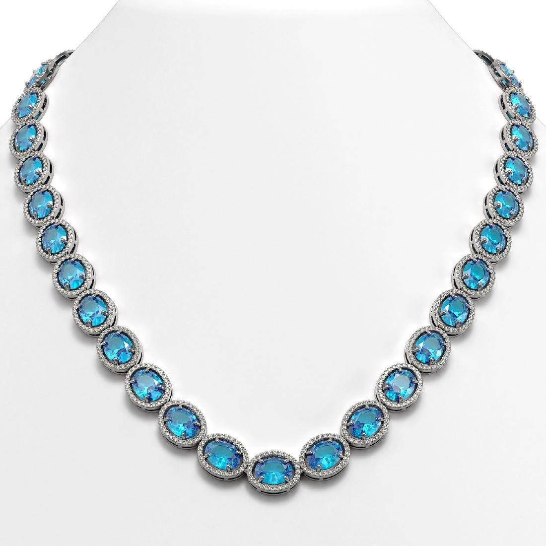 68.17 CTW Swiss Topaz & Diamond Halo Necklace 10K White