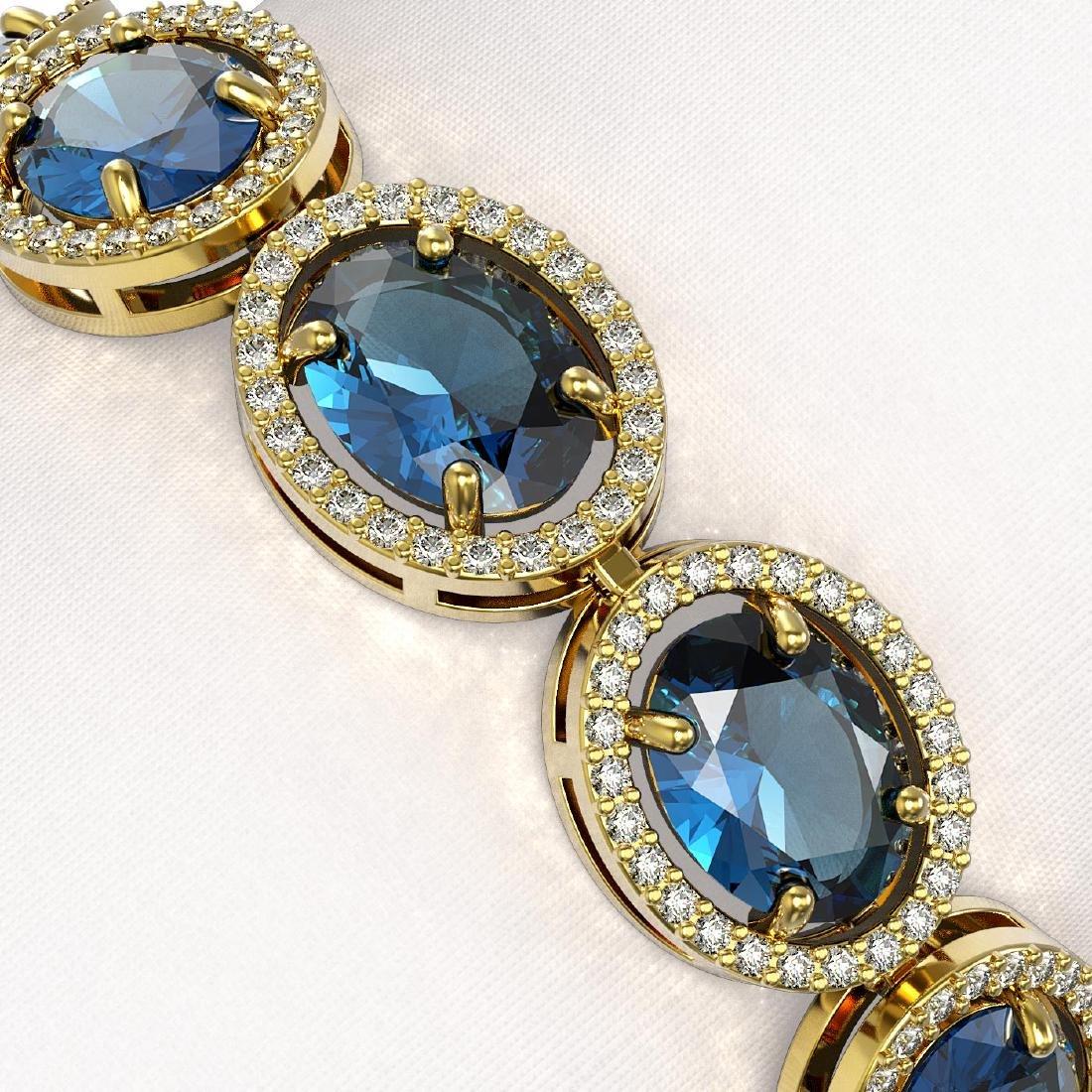 29.53 CTW London Topaz & Diamond Halo Bracelet 10K - 3