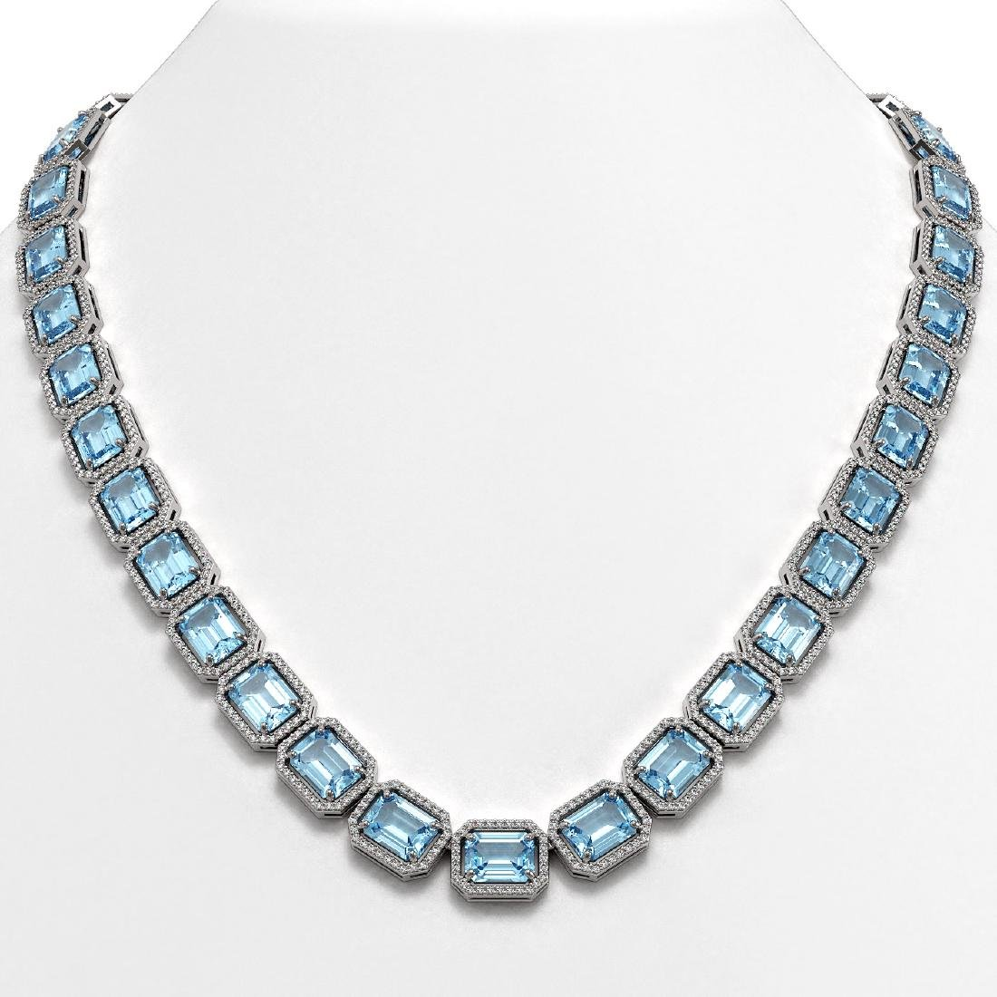78.34 CTW Sky Topaz & Diamond Halo Necklace 10K White