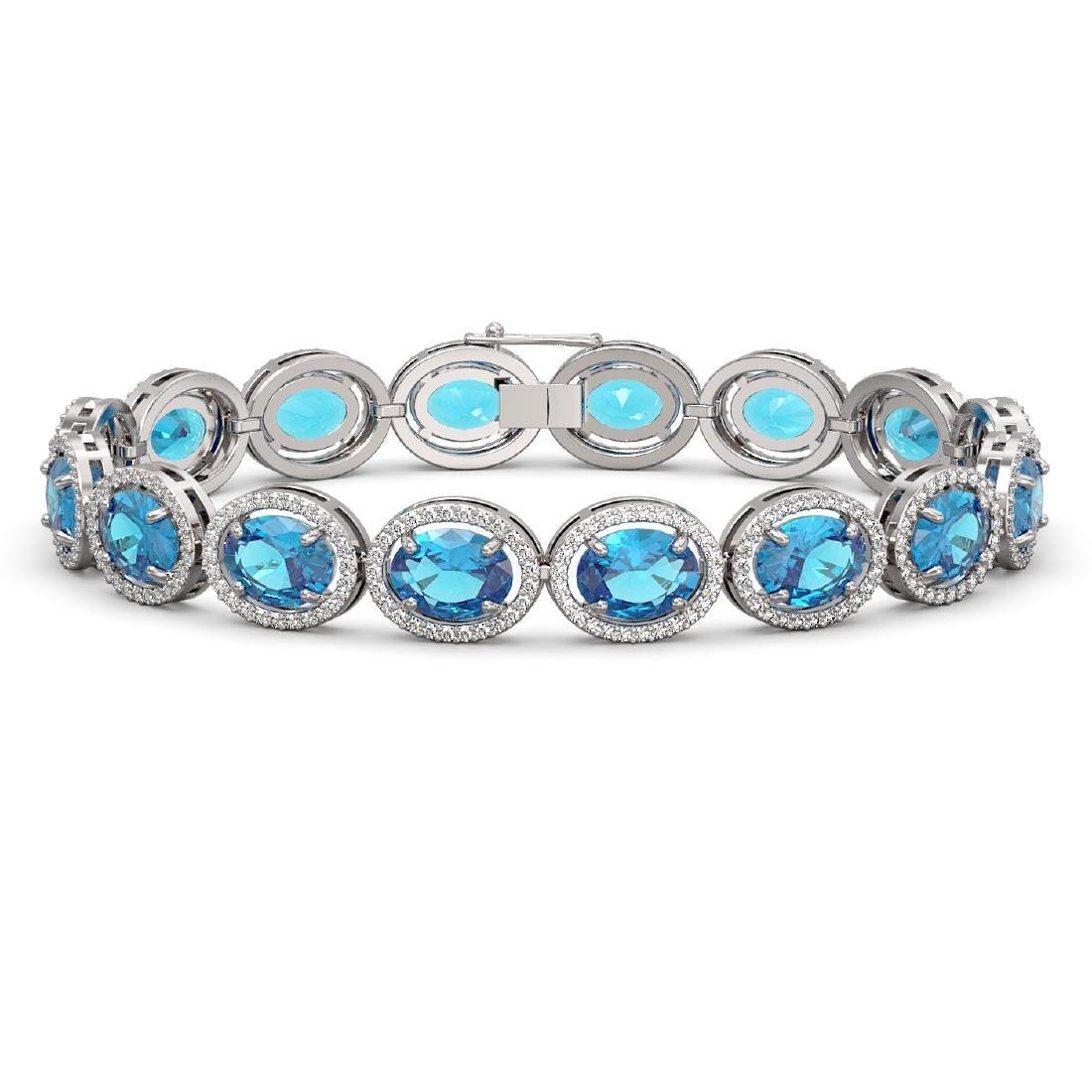 29.53 CTW Swiss Topaz & Diamond Halo Bracelet 10K White