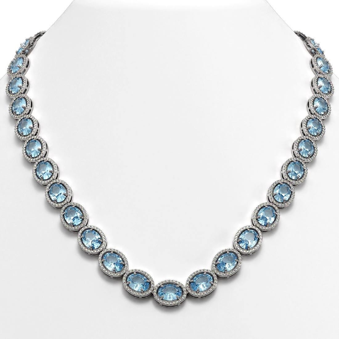 68.17 CTW Sky Topaz & Diamond Halo Necklace 10K White