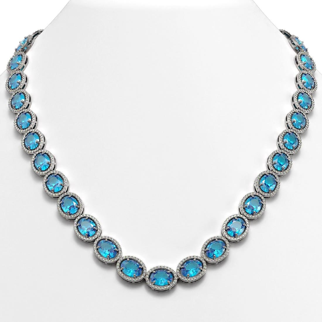 68.17 CTW Swiss Topaz & Diamond Halo Necklace 10K White