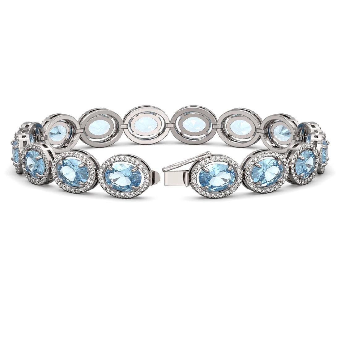 29.53 CTW Sky Topaz & Diamond Halo Bracelet 10K White - 2