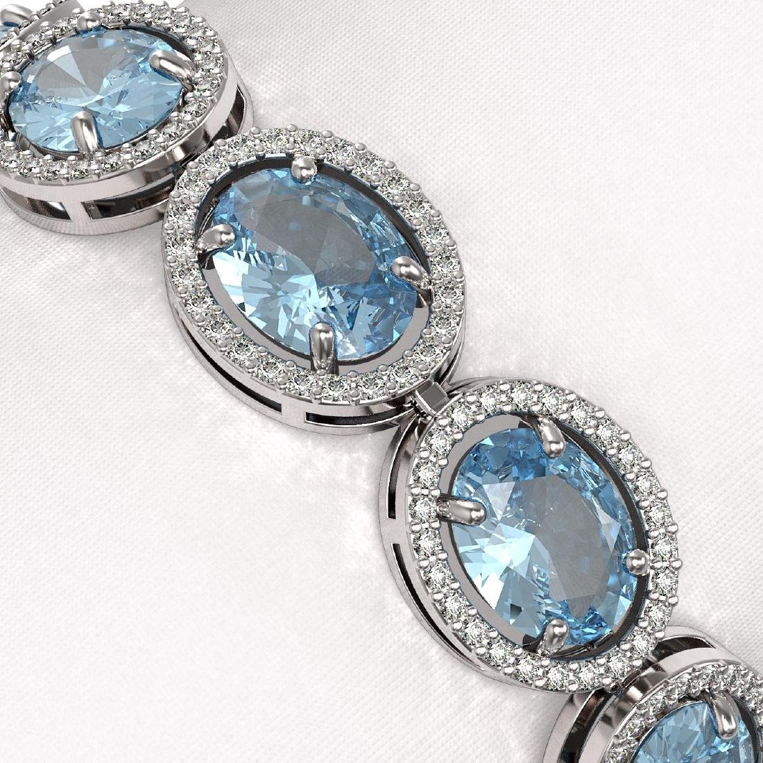 29.53 CTW Sky Topaz & Diamond Halo Bracelet 10K White - 3