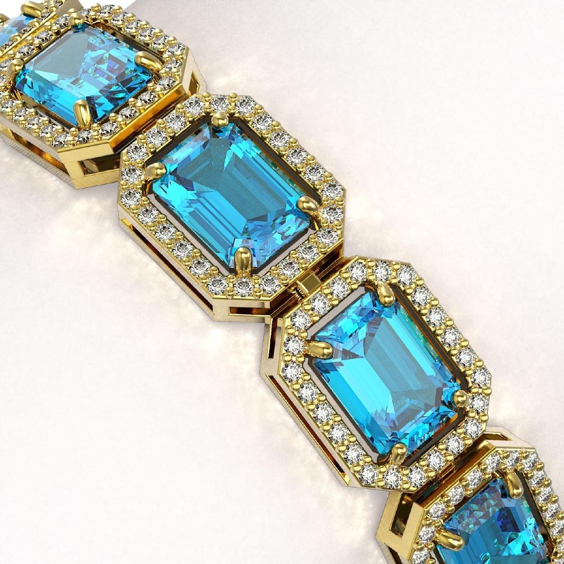 23.66 CTW Swiss Topaz & Diamond Halo Bracelet 10K - 3