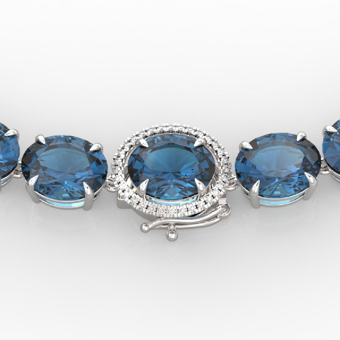 177 CTW London Blue Topaz & VS/SI Diamond Halo Micro