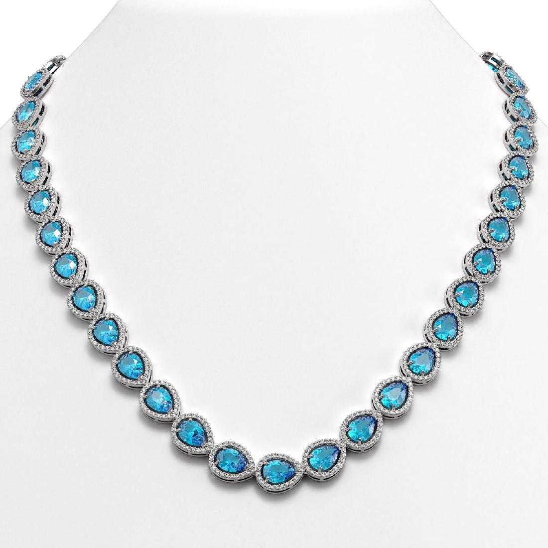 35.13 CTW Swiss Topaz & Diamond Halo Necklace 10K White
