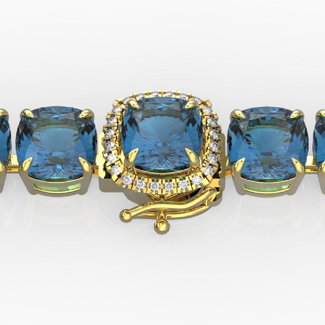 35 CTW London Blue Topaz & Micro VS/SI Diamond Halo