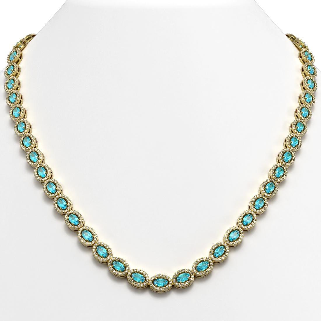 24.07 CTW Swiss Topaz & Diamond Halo Necklace 10K