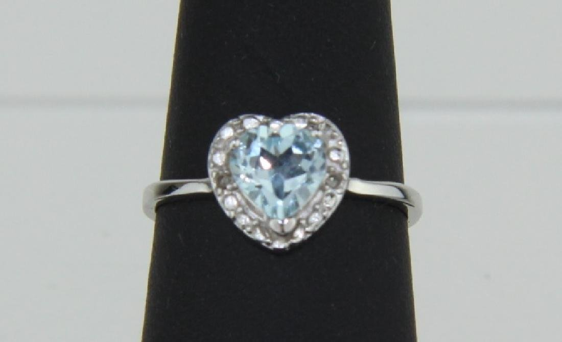 HEART CUT SKY BLUE TOPAZ RING IN STERLING SILVER
