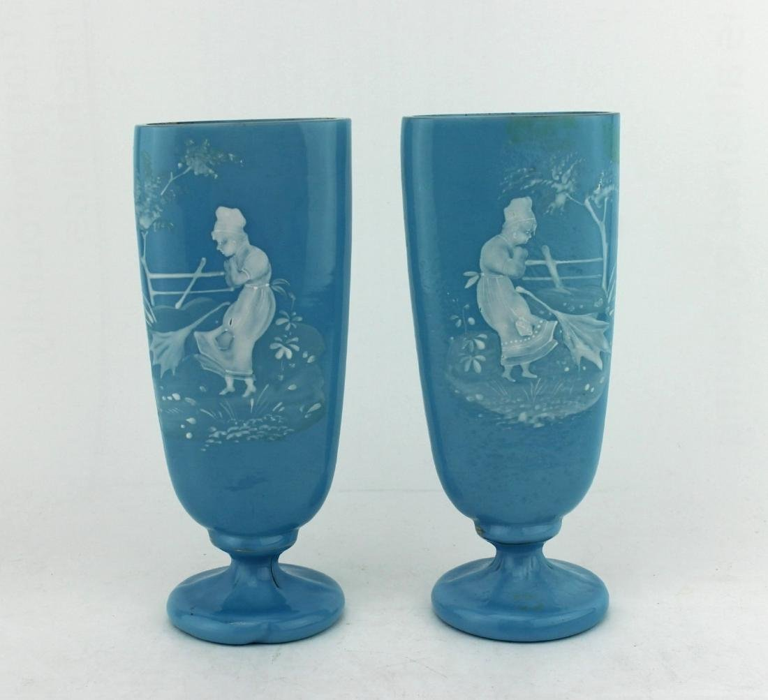 A PAIR OF MARY GREGORY BLUE GLASS VASES