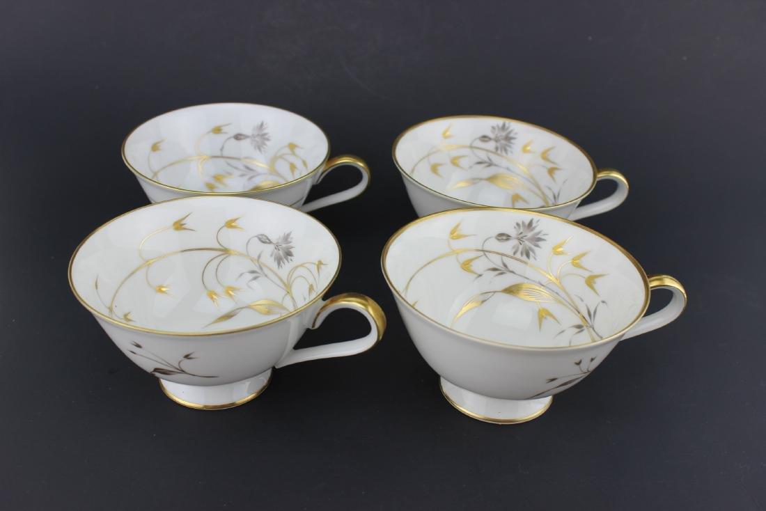 FOUR ASSORTED H & C HEINRICH TEA CUPS