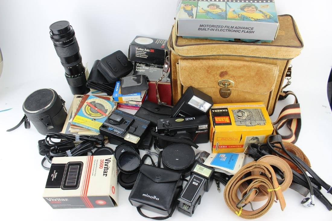 A LOT OF ASSORTED CAMERA S AND ACCESSORIES