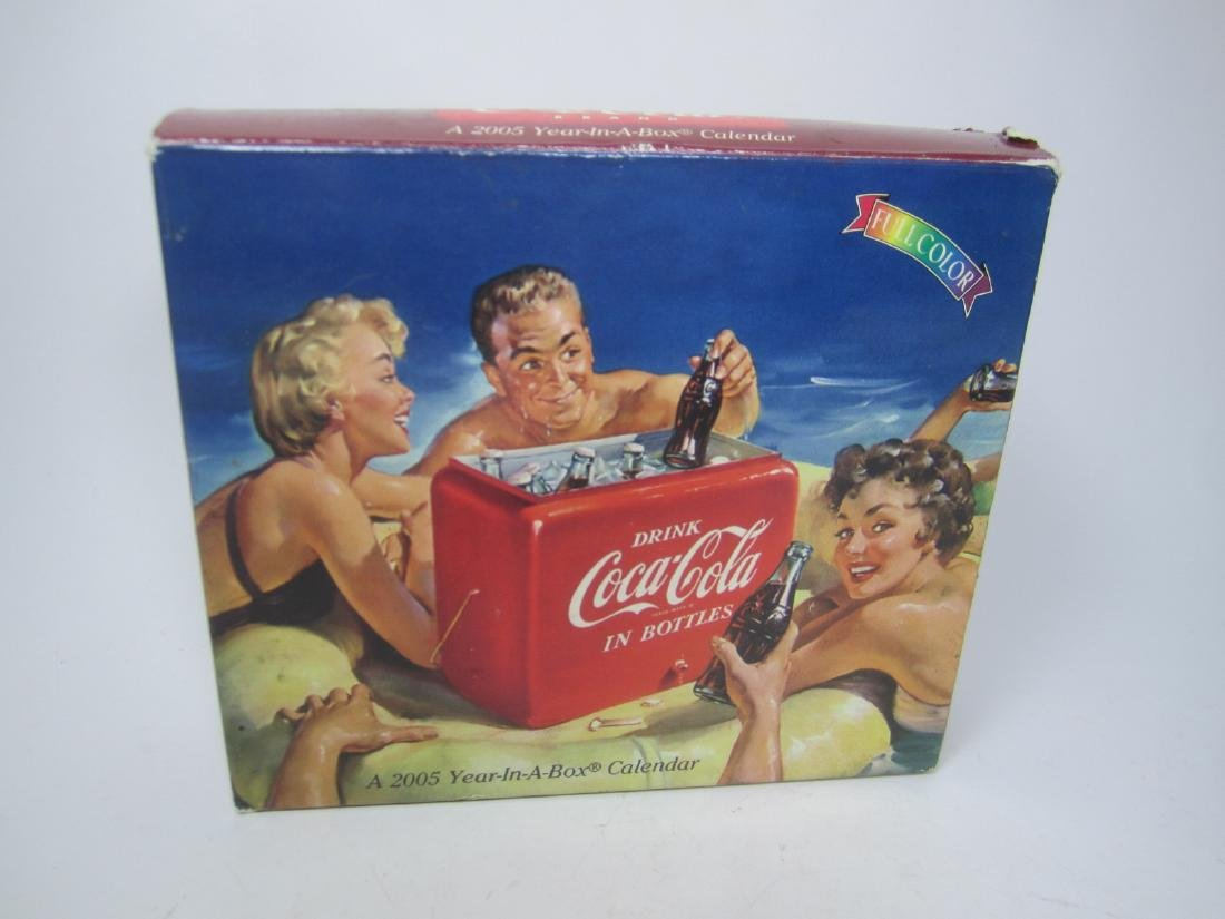 A COCA-COLA 2005 YEAR-A-BOX CALENDAR.