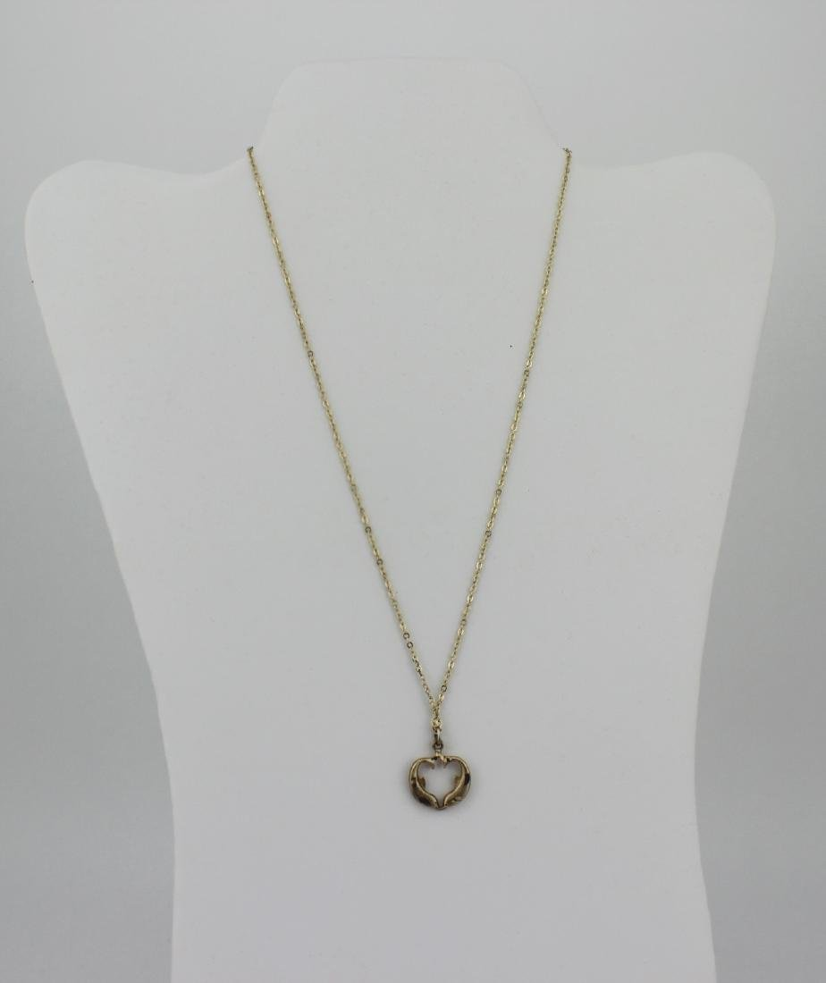 GOLD TONED SILVER NECKLACE WITH DOLPHIN PENDANT.
