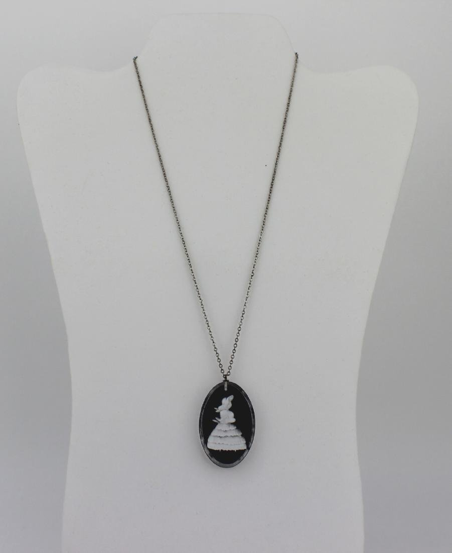 STERLING SILVER NECKLACE WITH FIGURINE PENDANT