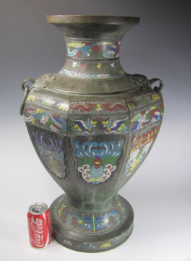 A LARGE CHAMPLEVE VASE WITH DOUBLE BEAST HEAD RING