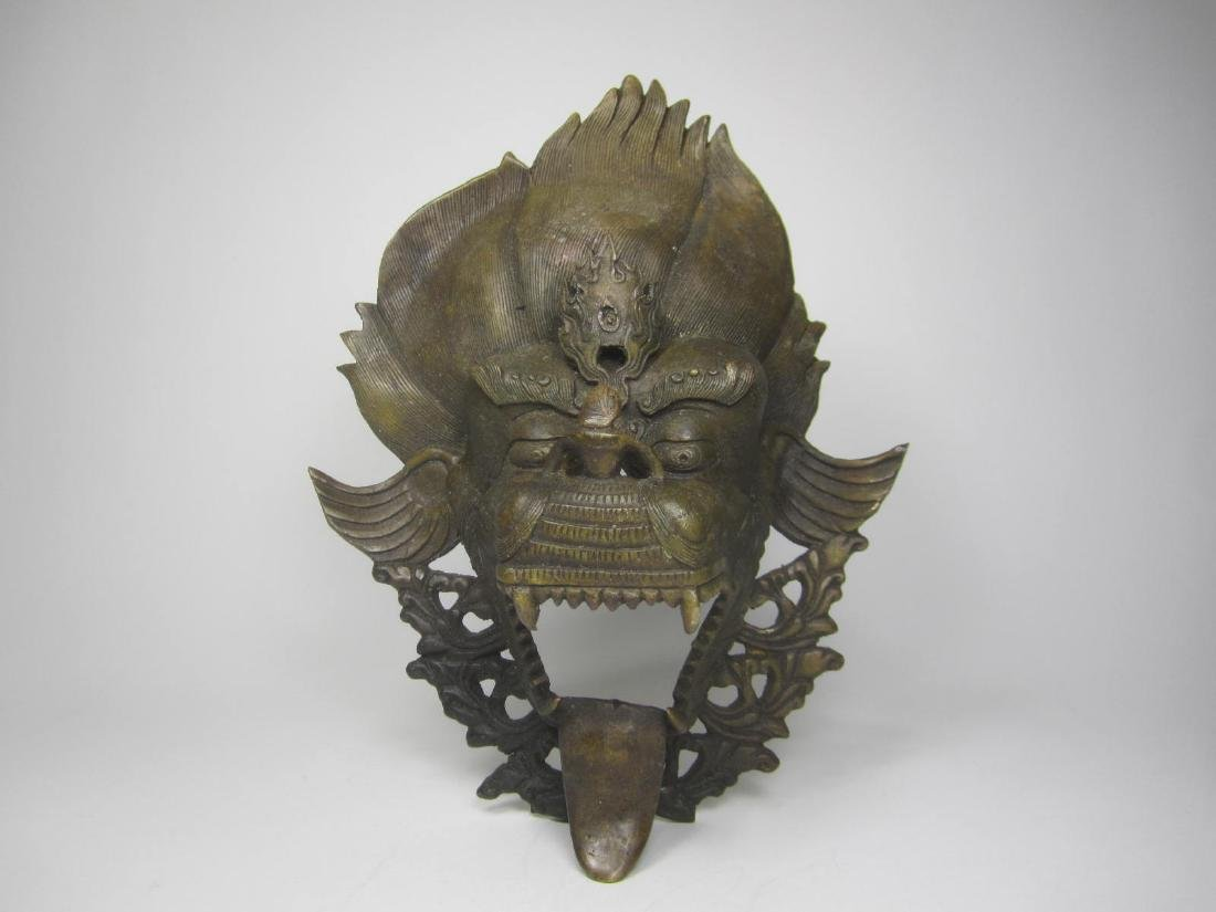 ANTIQUE BEAST HEAD WALL CANDLE HOLDER