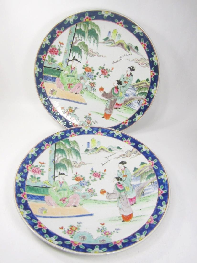 PAIR OF CHINESE FAMILLE ROSE CHARGERS