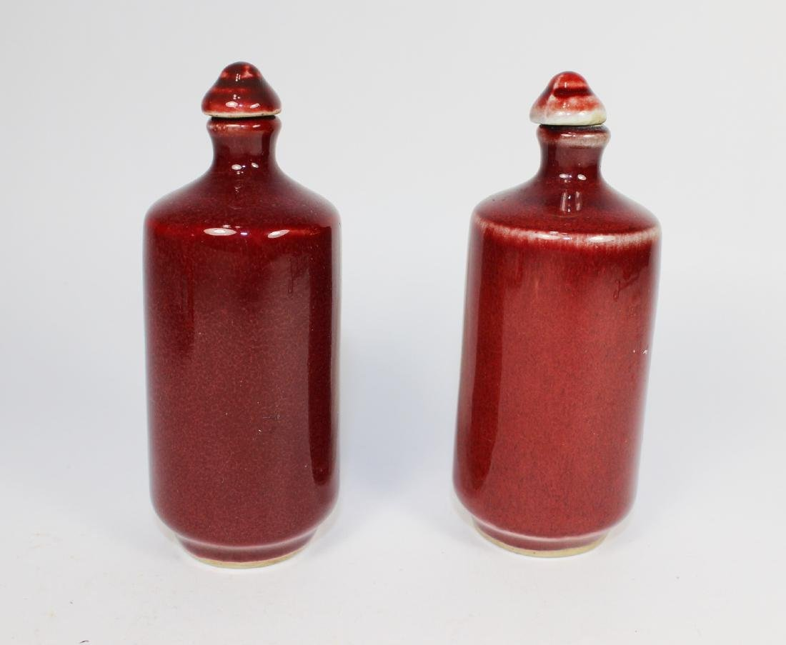 PAIR OF CHINESE SANG DE BOEUF SNUFF BOTTLES