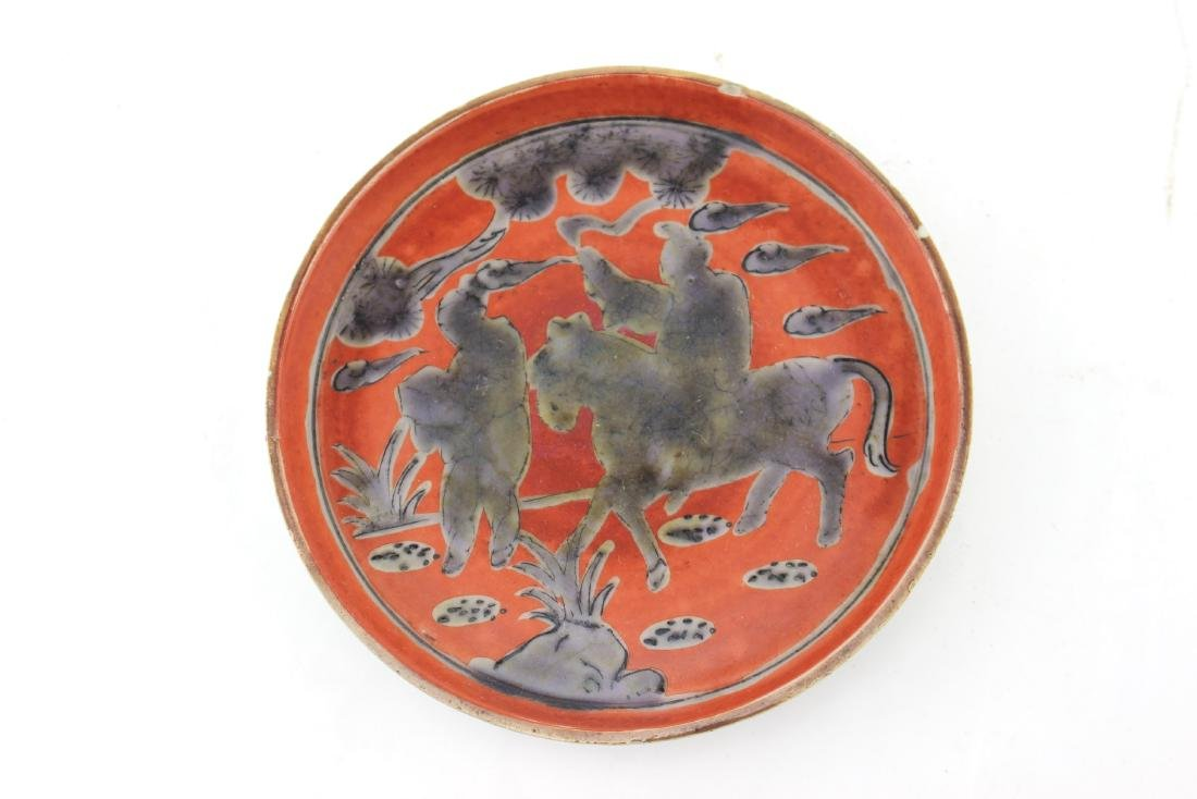 A CHINESE RED GLAZED PORCELAIN DISH